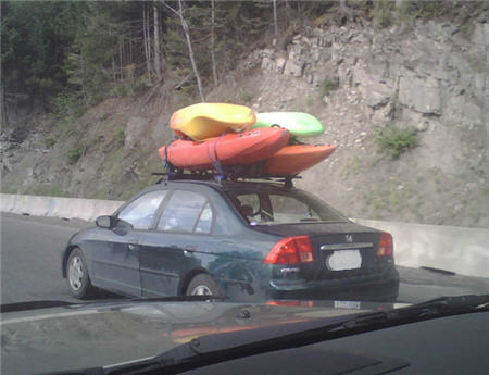 Four boats on a little car - these guys get an 'A' for effort.
