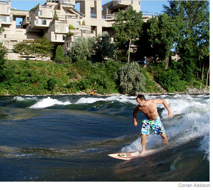 Corran Addison surfing the St. Lawrence River